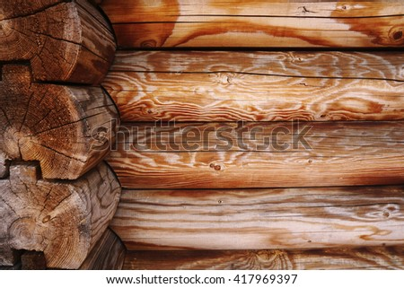 Natural wooden background. House from logs.  - stock photo