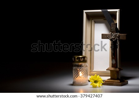 natural wooden mourning frame with crucifix, flower and candle for sympathy card - stock photo