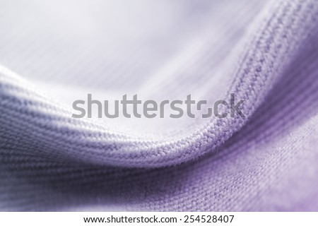 Natural wool clothes and fabrics: textile and fabric macro photo. - stock photo