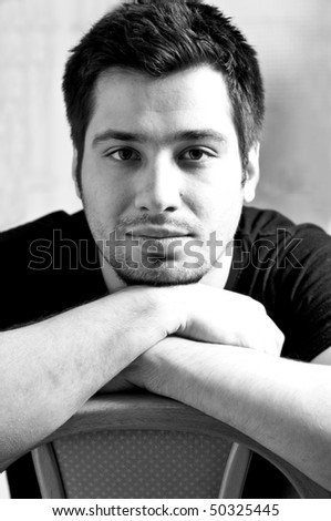 Naturally lid black and white portrait of a young man - stock photo