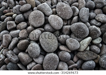 Naturally polished color rock pebbles background - stock photo