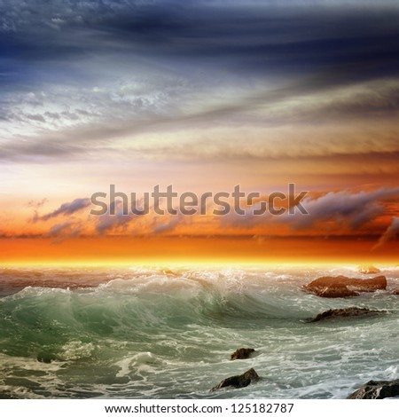 Nature background - beautiful sunset, sea with waves - stock photo