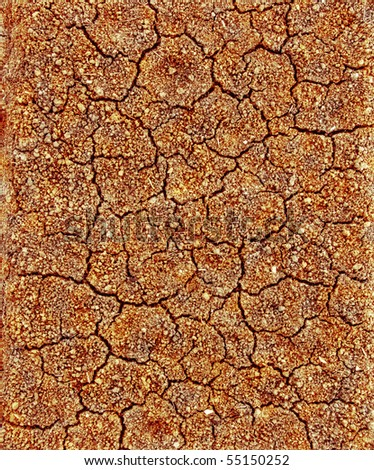 nature background cracked ground with clefts, perpendicular top view - stock photo