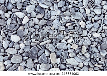 Nature background from gray sea pebbles - stock photo