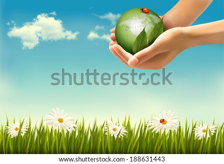 Nature background with hands holding a globe.  Raster version - stock photo