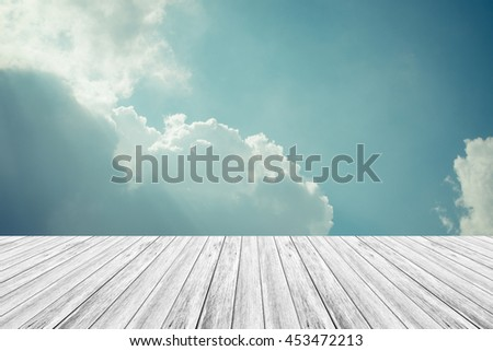Nature cloudscape with blue sky and white cloud with Wood terrace , process in vintage style - stock photo
