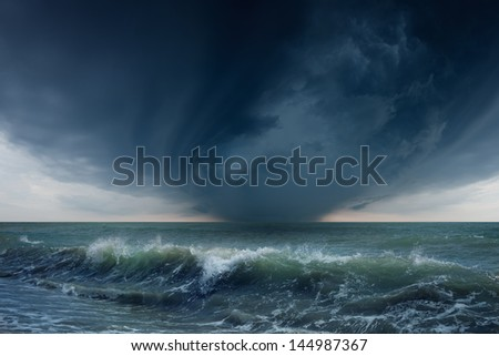 Nature force background - dark stormy sky and sea - stock photo