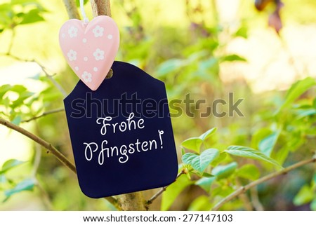 nature greeting card background - german for  happy pentecost - stock photo