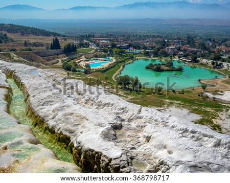 Nature landmarks in Turkey - landscape with travertines and turquoise water. Thermal springs and terrace in spa resort Pamukkale - natural reserve in Turkey. - stock photo