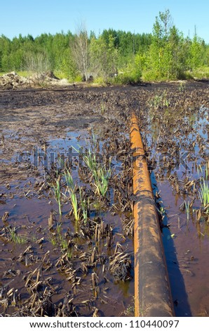 Nature pollution by oil products - stock photo