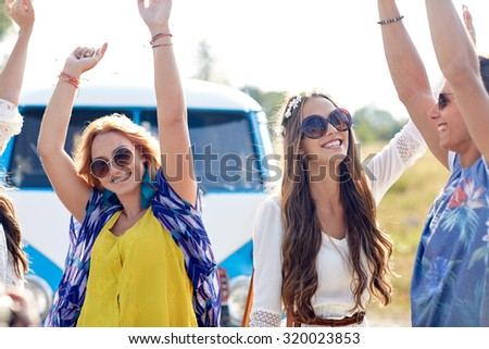 nature, summer, youth culture and people concept - happy young hippie friends dancing over minivan car outdoors - stock photo