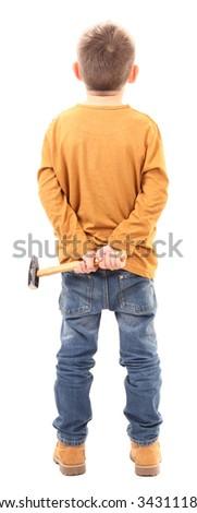 Naughty boy is hiding hammer behind - stock photo