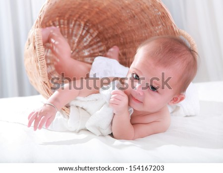 Naughty girl in a laundry basket. - stock photo