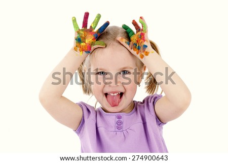 Naughty little girl playing with watercolors - stock photo