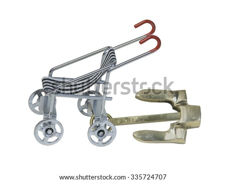 Nautical anchor on a stroller to represent anchor babies  - path included - stock photo