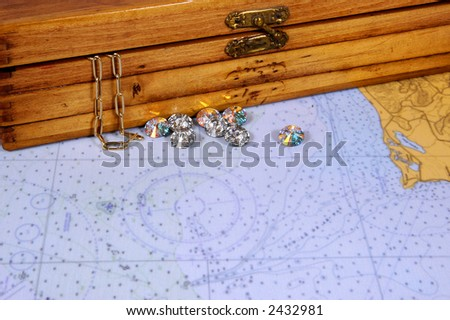 nautical chart with diamonds, gold and chest - stock photo