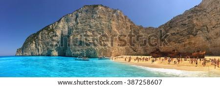 NAVAGGIO BAY/ZAKINTHOS ISLAND, GREECE - CIRCA JUNE 2015: Tourists flocking in famous Wreckship Pirate's Bay - stock photo
