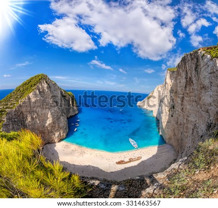 Navagio beach with shipwreck against azure sea on Zakynthos island in Greece - stock photo