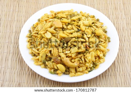 Navaratanmix,A combination of dried nuts blended with beaten rice and gram flour balls.a popular Asian snack. - stock photo