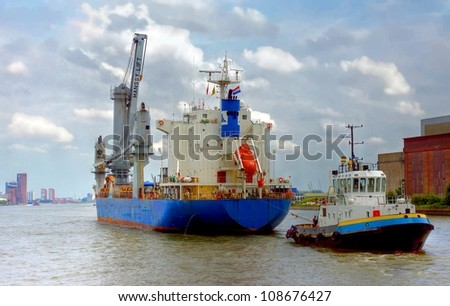 navigation of a big ship through the harbour of Rotterdam, Europoort in  the Netherlands - stock photo