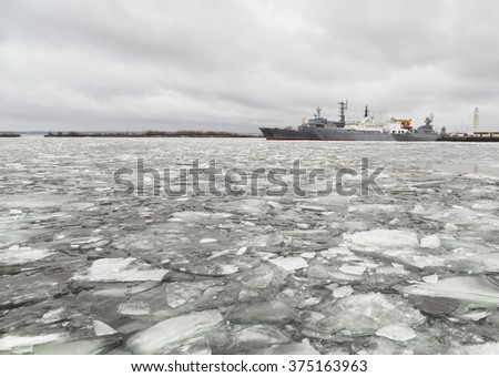 Navy ships in the port of Kronstadt. The Gulf of Finland. The Baltic Sea. Russia - stock photo
