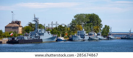 Navy warships moored at the wharf in the port of Gdynia, Poland. - stock photo