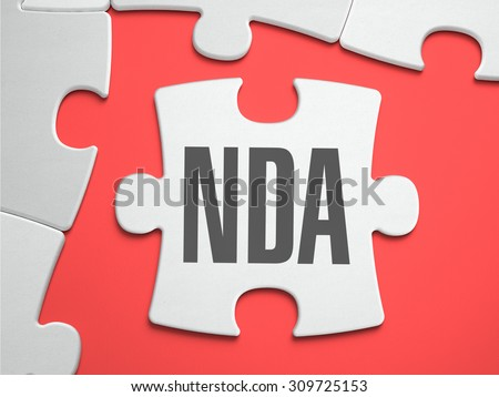 NDA - Non Disclosure Agreement - Text on Puzzle on the Place of Missing Pieces. Scarlett Background. Close-up. 3d Illustration. - stock photo