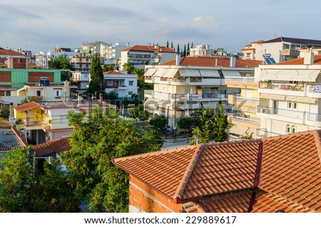 NEA KALLIKRATIA, GREECE - AUGUST 7, 2014:  traditional Greek low-rise buildings, view from above - stock photo