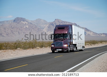 NEAR SHOSHONE, CA, USA - APRIL 21, 2007: a truck drives on Route 127. Trucks carry nearly 70 percent of all freight transported annually in the U.S. - stock photo