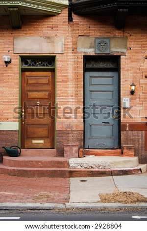 Near symmetry between two front doors, side by side.  Philadelphia, PA. - stock photo