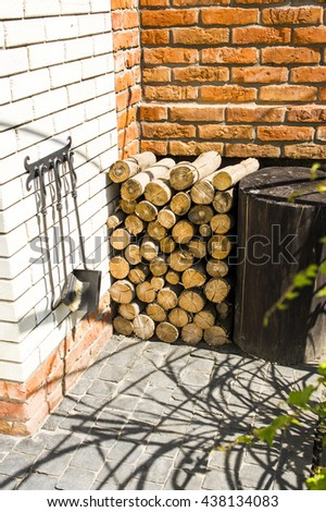 near the fireplace firewood stacked - stock photo