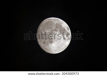nearly full moon, the picture of the moon one day before full moon night - stock photo