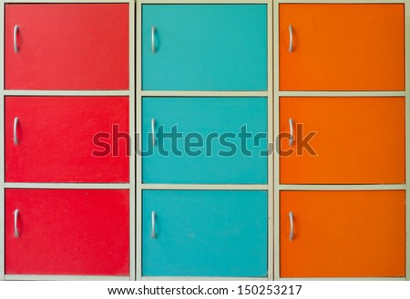 Neat and organized by the colors of the filing cabinet. - stock photo
