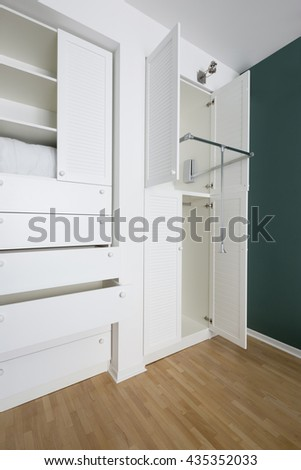 Neat and practical closet in the house - stock photo