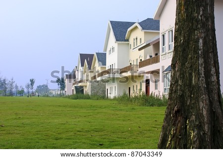 neat and tidy home in suburban residential area - stock photo