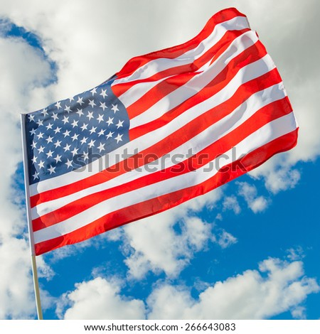 Neat USA flag and cumulus clouds on background - stock photo