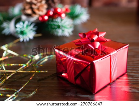 Neatly wrapped christmas gift. - stock photo