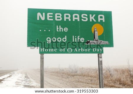 Nebraska Welcome Sign - seen during foggy day. - stock photo
