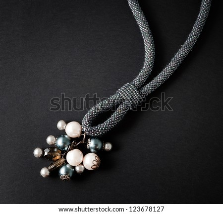 necklace on black background - stock photo