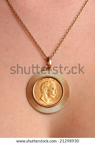 Necklace with old gold coin. - stock photo