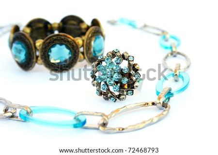 Necklaces, bracelet and ring  isolated on white background. - stock photo