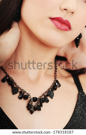Neckless on elegant woman neck - stock photo