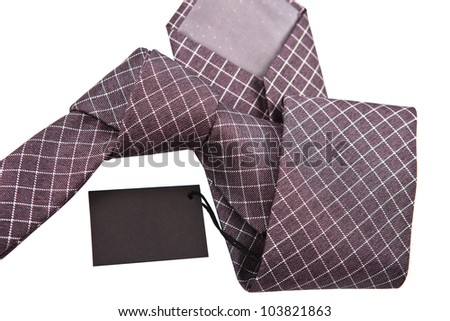 necktie with label close up on white background - stock photo