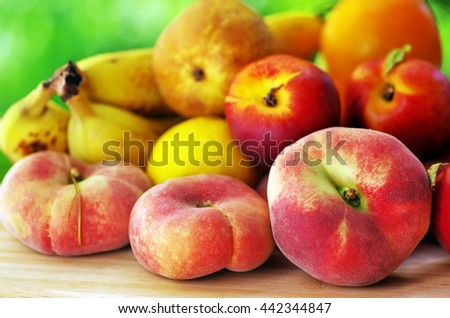 Nectarines, Peach  on wooden table - stock photo