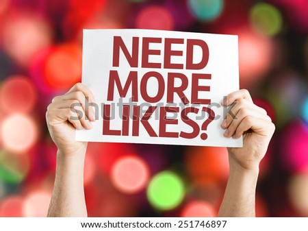 Need More Likes? card with colorful background with defocused lights - stock photo
