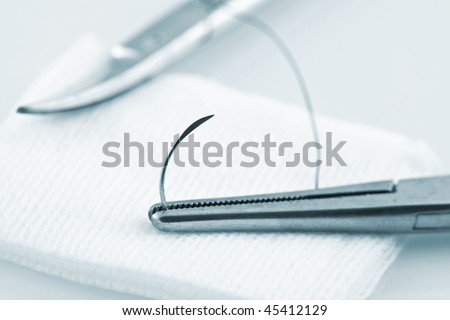 Needle Holder Holding Cat Gut Suture - stock photo