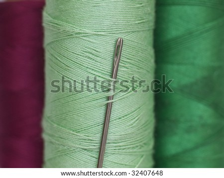 needle in the green bobbin - stock photo