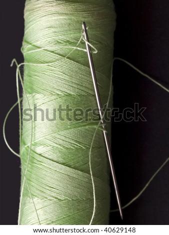 needle in the green bobbin - stock photo