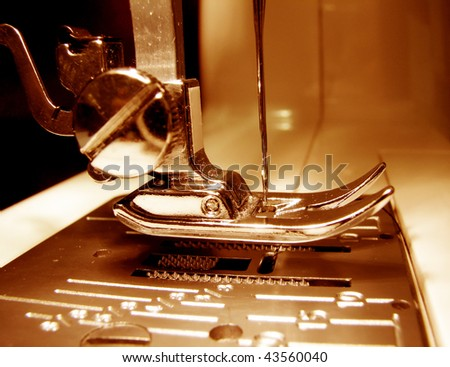 Needle plate and foot of a sewing machine - close up - stock photo