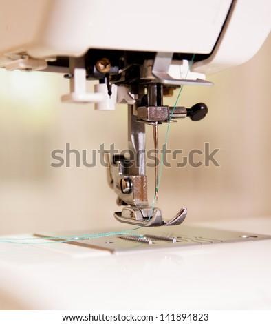 Needle - sewing machine - stock photo